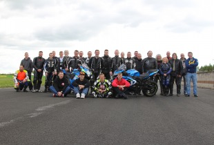 Group photo of riders and coaches at James Whitham track training day at Croft