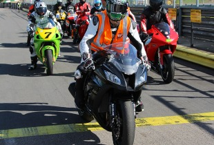 Ian Hutchinson leads out a group of riders at a James Whitham motorcycle track training day event.