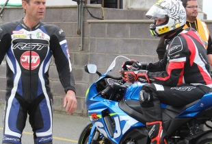 James Whitham prepares to let the riders onto the track at Anglesey.